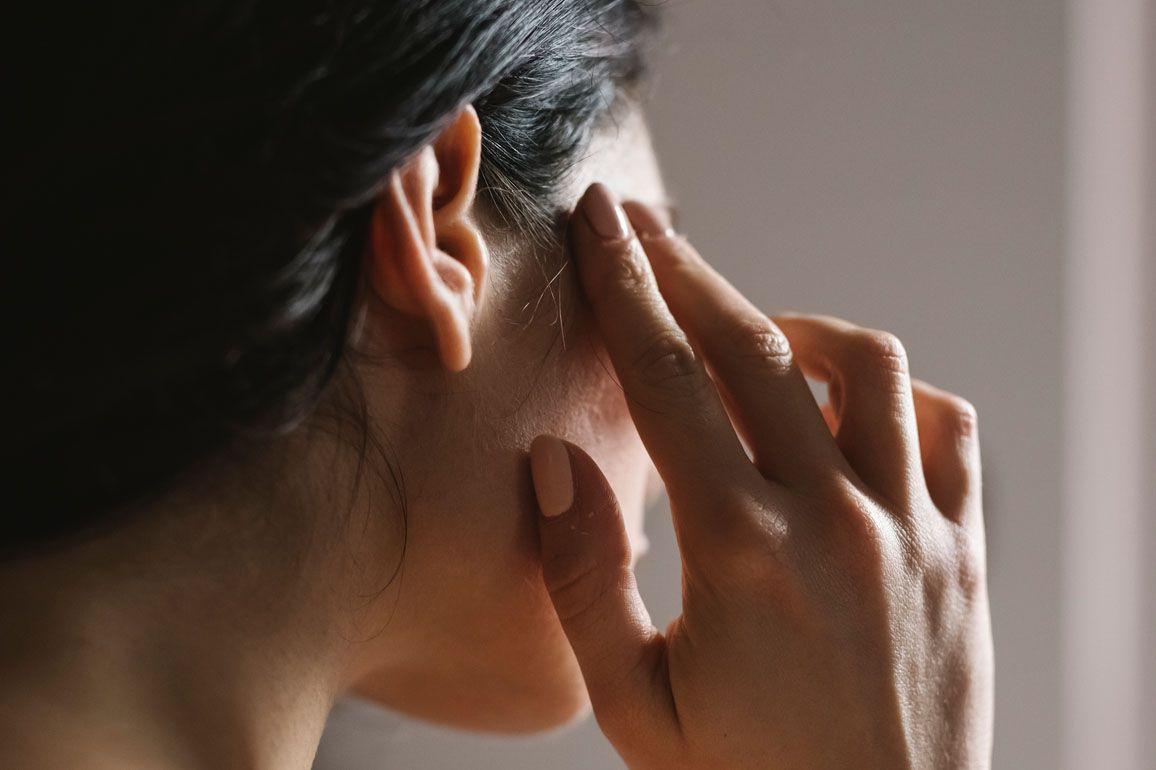 a woman massaging her head