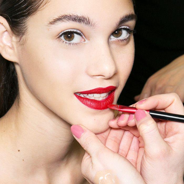 woman having lipstick applied
