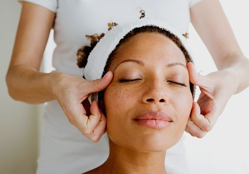 relaxed person receiving a massage