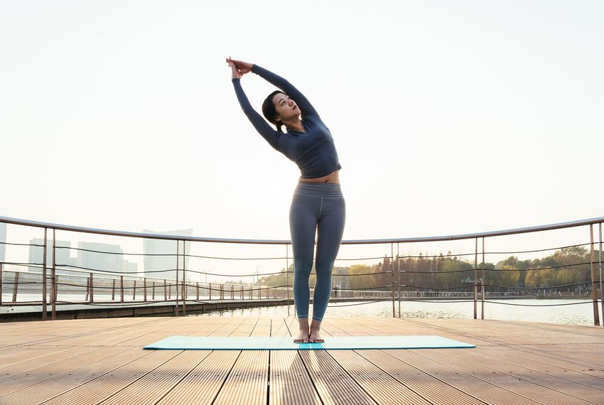 A young woman is practicing yoga