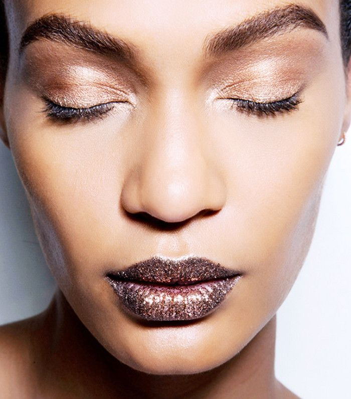 Model with shimmery rose gold eyelids