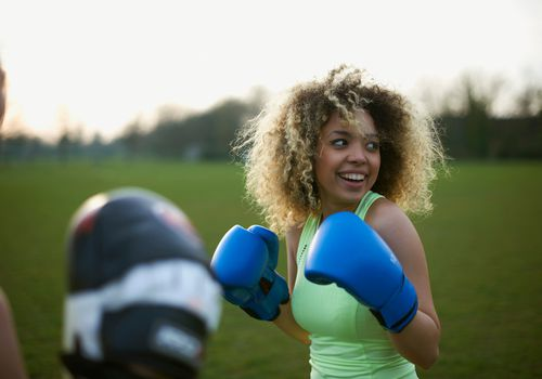 Woman boxing outdoors