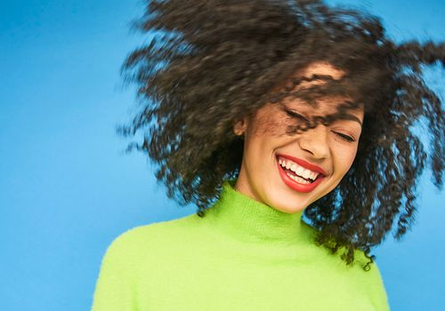 laughing person in studio portrait