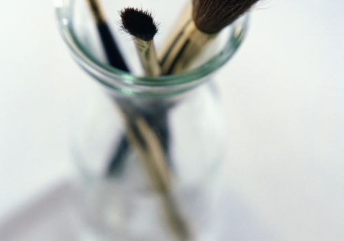 makeup brushes in an open jar