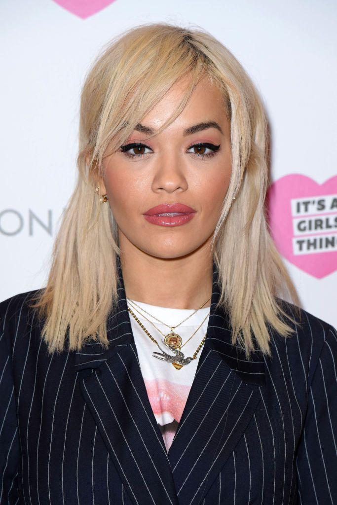 Rita Ora straight blonde shoulder-length hair with side-swept bangs