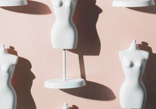 mannequins against a pink wall