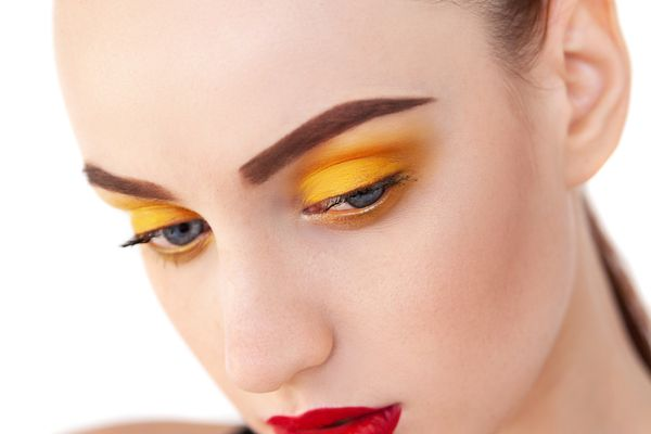 woman with yellow eye shadow
