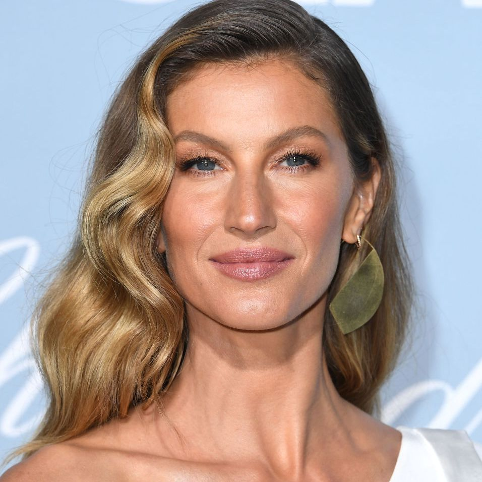 Giselle long, loose waves with side-part