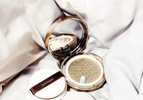 sulwhasoo cushion compact on a bed