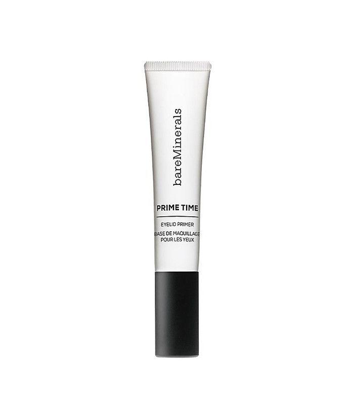 Tube of white eye shadow primer on a white background.