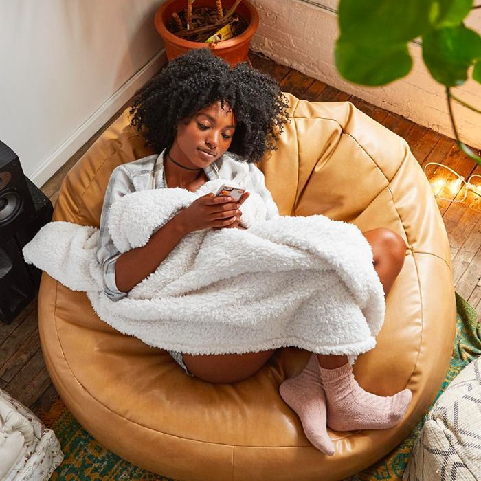 Woman scrolling on cellphone at home
